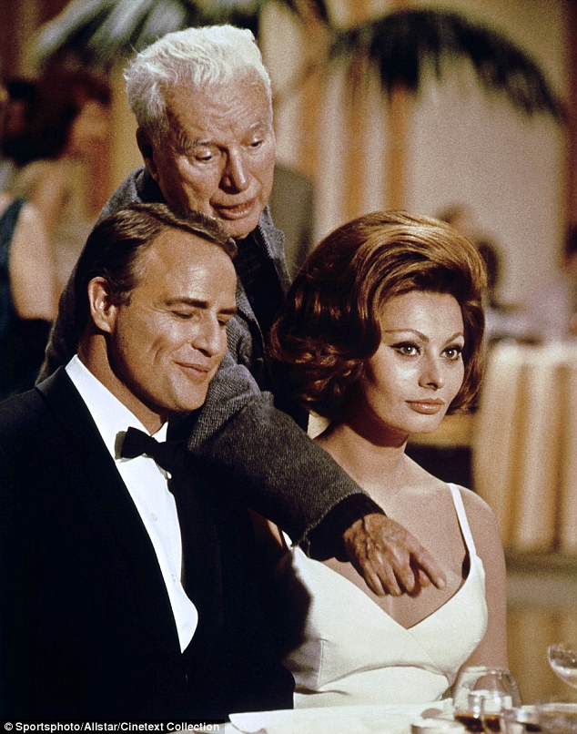 Oscar-winner: Sophia, pictured with Marlon Brando (left) and Charlie Chaplin (centre) in a scene from the film A Countess From Hong Kong, is one of Italy