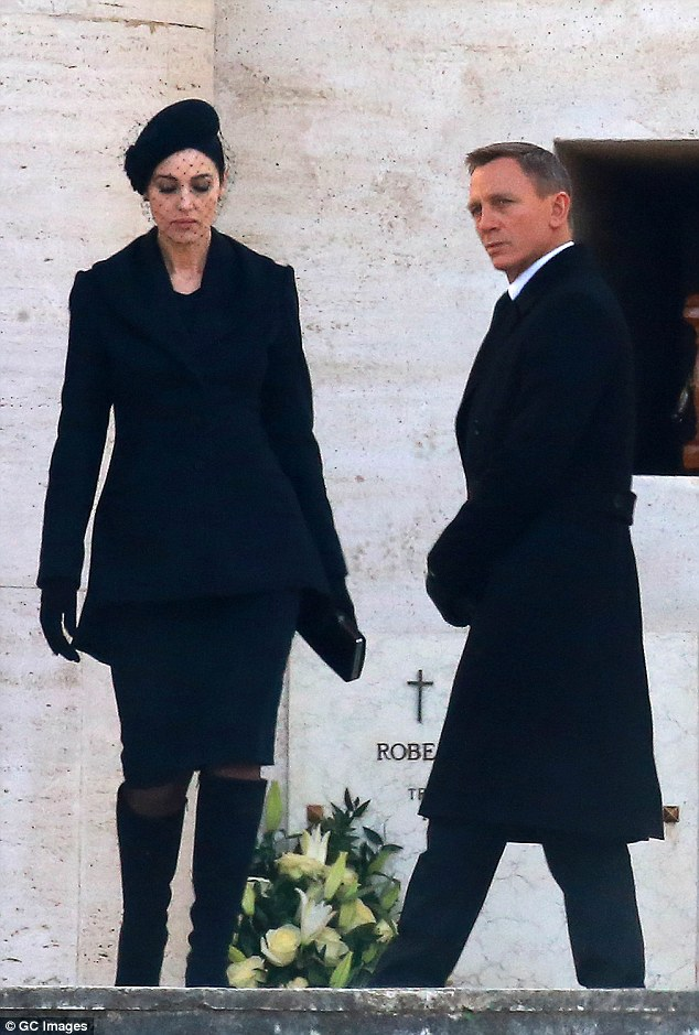 Handsome pair: The two actors cut extremely stylish figures in their all black ensemble