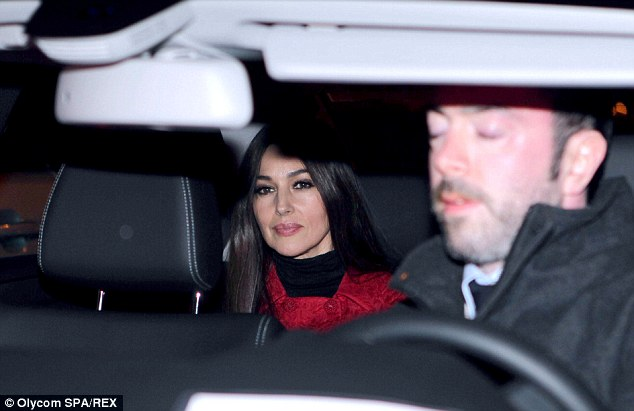Beautiful: Monica clearly enjoyed her evening meal with the Bond icon and their crew-mates