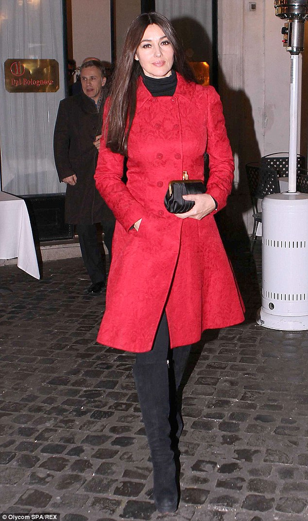 Glam: Daniel Craig and Monica Bellucci stepped out for a friendly evening meal in Rome on Thursday