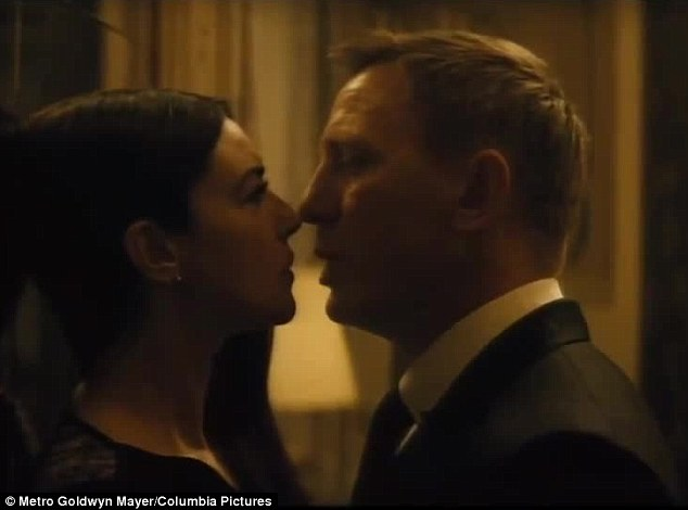 Steamy: Daniel Craig gets up caught up with Monica Bellucci in the latest Spectre clip