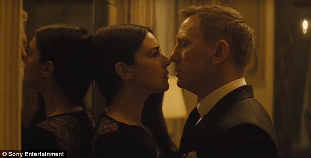 Steamy: Bond backs Lucia against a mirror during their loaded exchange, leaning in for a kiss