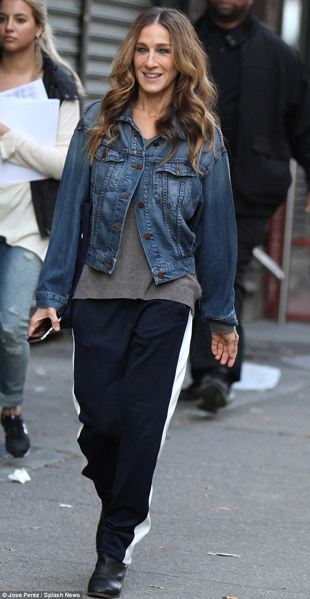 Laid back Jess: Although previously dressed as an uptown princess, the actress showed her casual side in a Gap-inspired look, wearing a pair of navy pants from Tory Sport