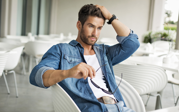 Handsome man touching his hair - Why Scorpio Men Are Not Forthcoming With Their Feelings