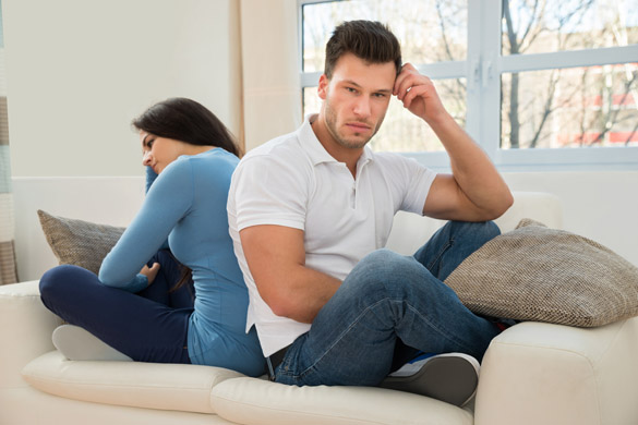 Portrait Of A Displeased Couple Sitting Back To Back On Couch - What to do if your Scorpio Man starts Ignoring you