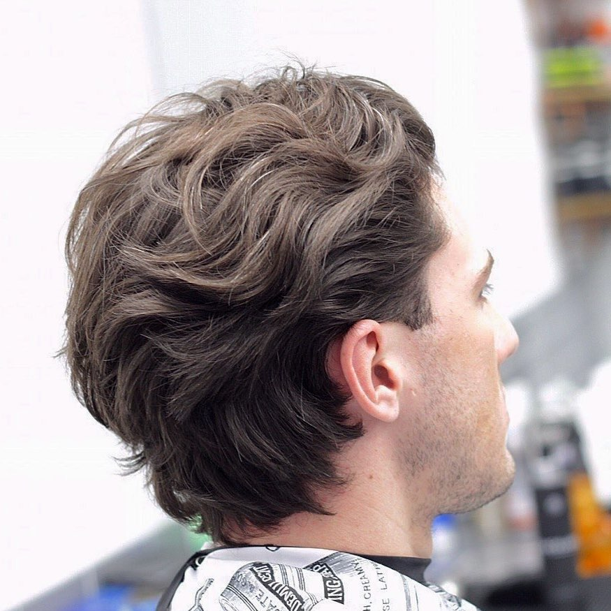 Medium length taper cuts for wavy hair men